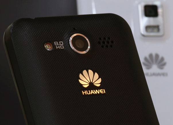 Huawei mobile phones are displayed in one of its offices in Shenzhen