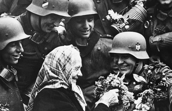 OCTOBER 4TH 1938, SUDETENLAND, FRIEDLAND, GERMAN TROOPS WELCOME BY AN OLD WOMAN