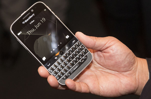 BlackBerry CEO Chen holds up the unreleased Blackberry Classic device during the company's annual general meeting for shareholders in Waterloo