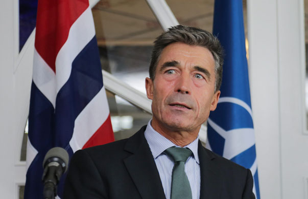 NATO Secretary General Rasmussen answers questions at a press meeting in Arenda