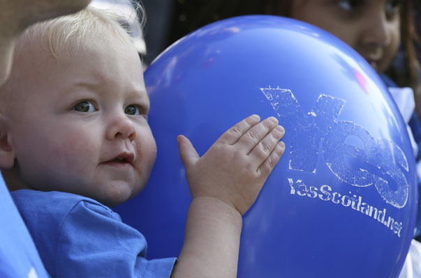 A child holds a 'Yes' balloon as Scotland's First Minister Alex Salmond campaigns in Edinburgh, Scotland