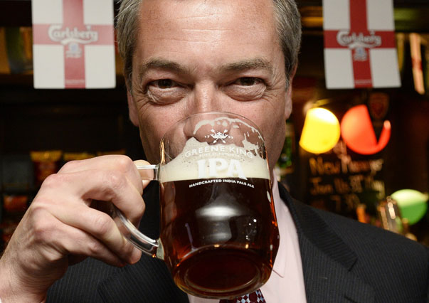 The leader of Britain's UKIP party Nigel Farage drinks a pint at the Hoy and Helmet pub in South Benfleet