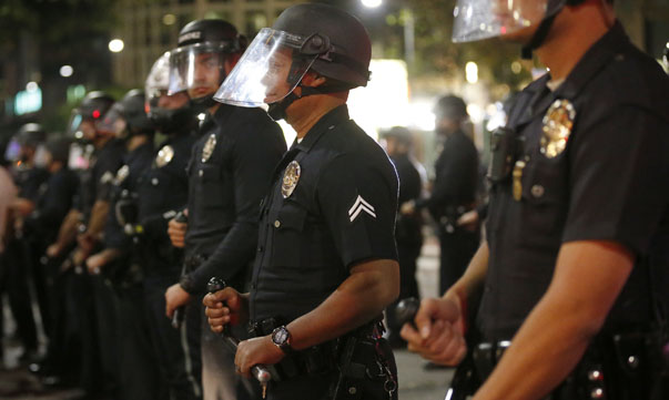 Police corral protesters before making mass arrests in Los Angeles, following Monday's grand jury decision in the shooting of Brown