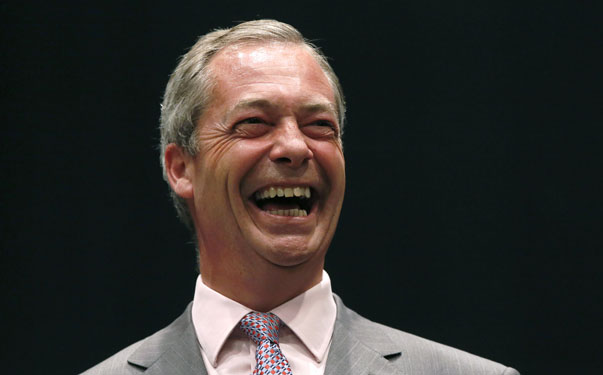 UK Independence Party (UKIP) leader Nigel Farage laughs after the declaration of the results of the European Parliament election for the south east region, in Southampton