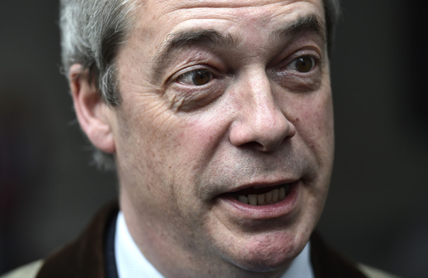 Leader of the UK Independence Party (UKIP), Farage speaks with a journalist as he leaves the BBC  New Broadcasting House following a radio interview in London