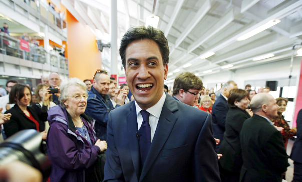 Britain's opposition Labour Party leader Miliband walks through a crowd gathered for at a campaign event in Warwick, central England