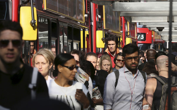 Commuters emerge from Victoria Station in London