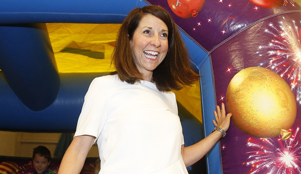 Labour Party leadership candidate Liz Kendall joins children on a bouncy castle during her visit to a Kidszone project in Manchester