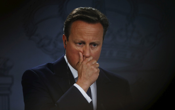 Britain's PM Cameron gestures during a joint news conference with Spain's PM Rajoy at Moncloa palace in Madrid