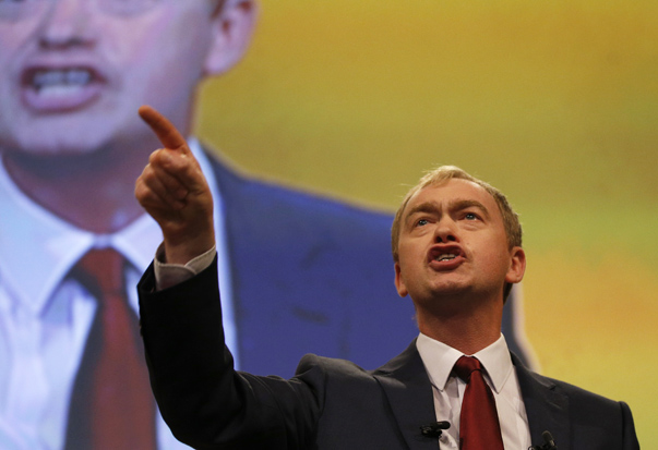Britain's Liberal Democrat party leader, Tim Farron, gestures during his keynote speech on the final day of the party's conference in Bournemouth