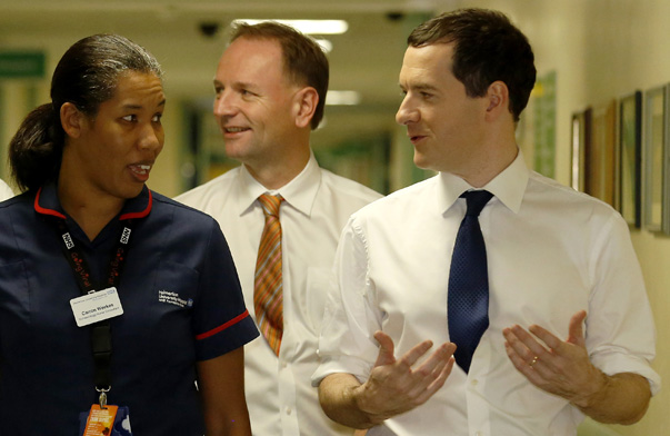 Britain's Chancellor of the Exchequer George Osborne (R) speaks with Divisional head of nursing Carron Weekes (2nd L), accompanied with Health Minister Jeremy Hunt (L) and Simon Stevens Chief Executive of NHS England, at the Homerton University Hospital NHS Foundation Trust at Homerton in east London November 30, 2014. British finance minister George Osborne announced a 2 billion pound annual increase in healthcare spending on Sunday, seeking to counter political attacks on his Conservative party's handling of the health service six months before an election. REUTERS/Luke MacGregor (BRITAIN - Tags: BUSINESS POLITICS HEALTH) - RTR4G4A5