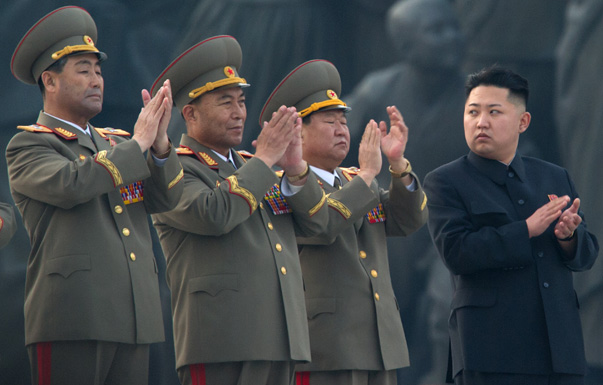 North Korean leader Kim Jong-Un (R) claps as he attends the unveiling ceremony of two statues of former leaders Kim Il-Sung and Kim Jong-Il in Pyongyang on April 13, 2012. North Korea's new leader Kim Jong-Un on April 13 led a mass rally for his late father and grandfather following the country's failed rocket launch. AFP PHOTO / Ed Jones (Photo credit should read Ed Jones/AFP/Getty Images)