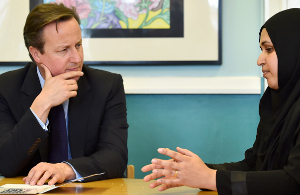 "Britain's Prime Minister David Cameron listens during a discussion with members of the local community on a visit to Luton, north of London, on October 19, 2015 to announce a new government strategy for tackling extremism. British Prime Minister David Cameron unveiled a new strategy on Monday to combat extremism, saying the battle was ""perhaps the ""defining one of this century"", but his proposals were condemned by Muslims as demonising their communities and set to fail.    REUTERS/Ben Stansall/Pool - RTS53LD"
