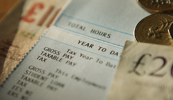 LONDON, ENGLAND - FEBRUARY 17: In this photo illustration notes and coins are displayed with a pay slip on February 17, 2010 in London, England. As the UK gears up for one of the most hotly contested general elections in recent history it is expected that the economy, immigration, the NHS and education are likely to form the basis of many of the debates. (Photo by Peter Macdiarmid/Getty Images)