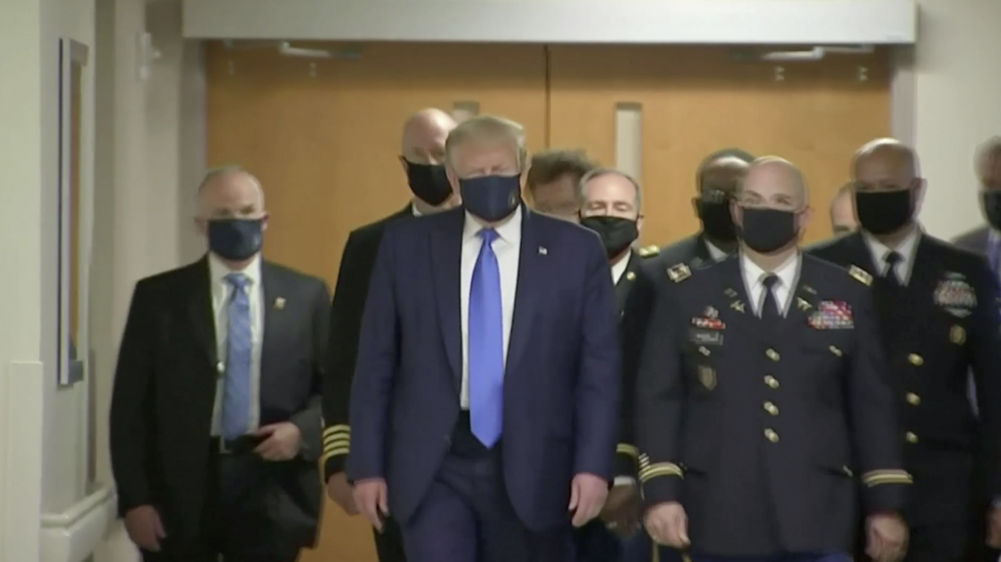Donald Trump wears a face mask for the first time in public – as Florida confirms 15,000 new cases of coronavirus - channel 4