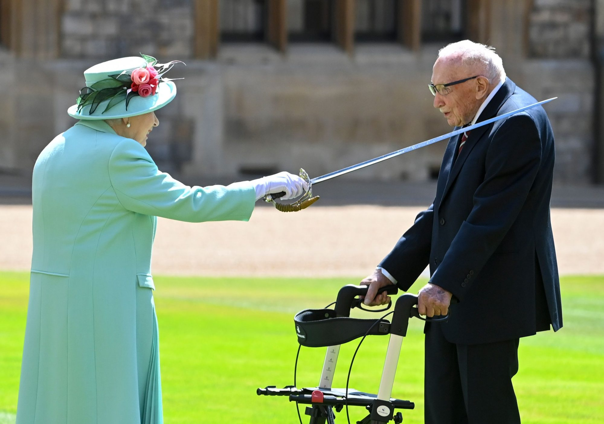 Capt Tom Moore becomes Sir Tom after being knighted by Queen ...