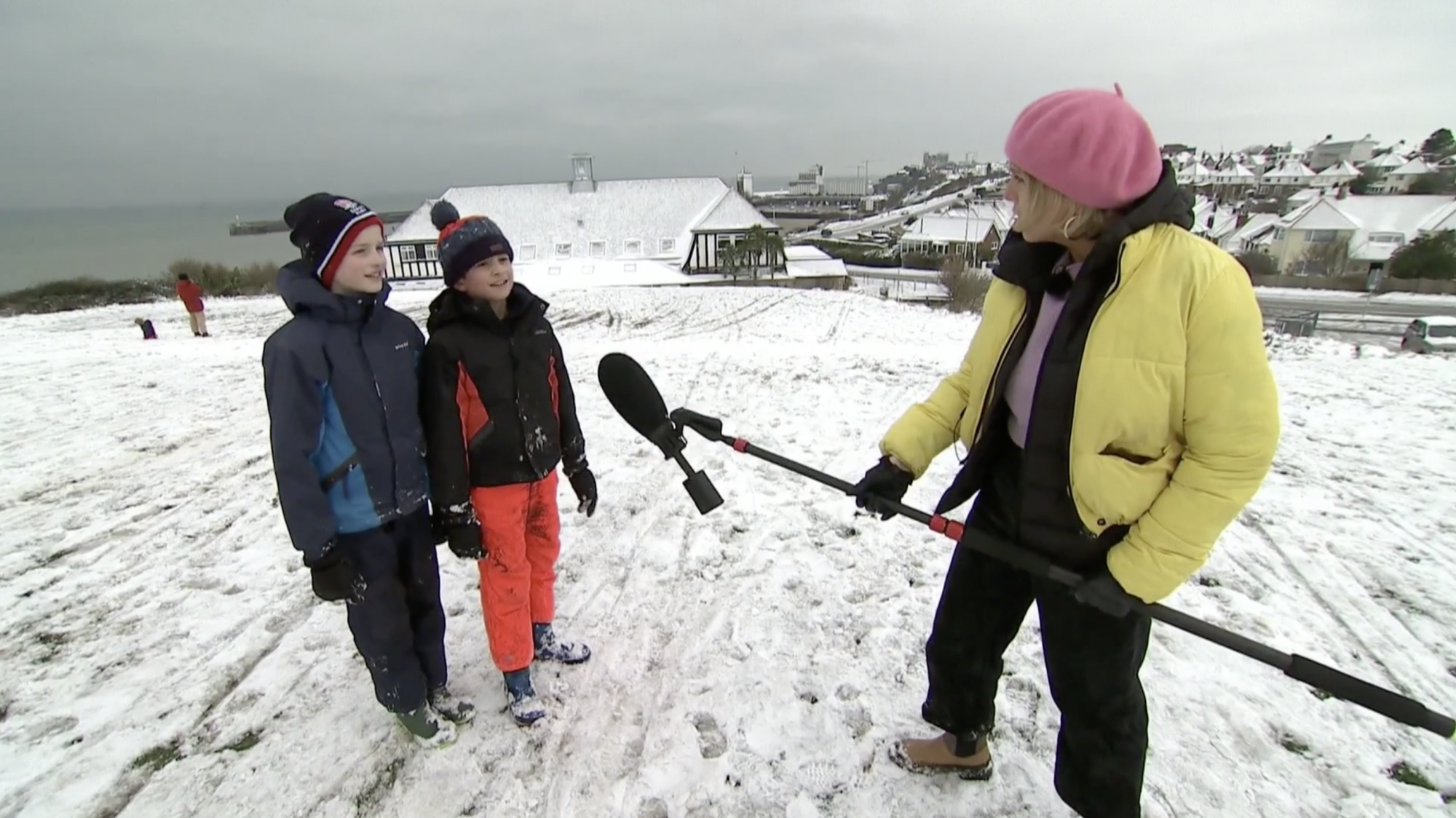 Children make the most of the snow in lockdown Britain